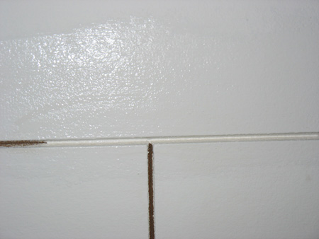 Partially painted acoustic ceiling tiles