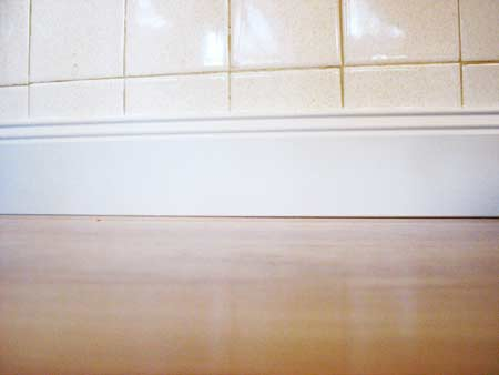 White floor base molding